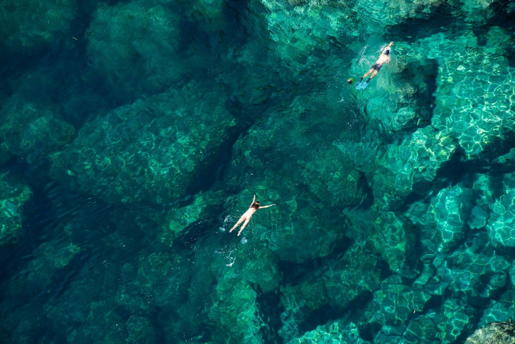 Drone view of a couple snorkeling in the sea